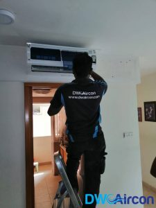 technician-repairing-aircon-not-cold-dw-aircon-singapore