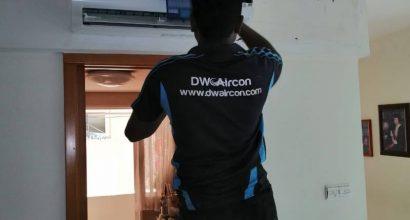 technician-repairing-aircon-not-cold-dw-aircon-singapore
