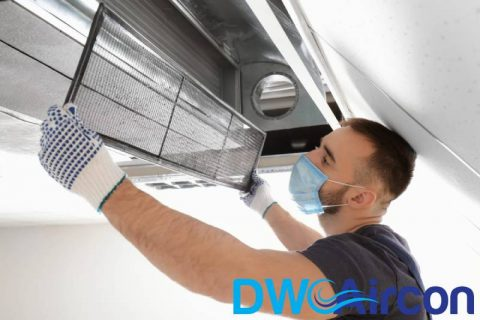 man-checking-aircon-aircon-odour-dw-aircon-singapore