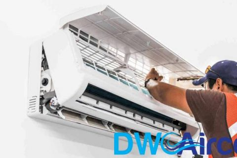 man-repairing-ac-unit-aircon-servicing-dw-aircon-singapore