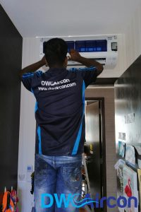 ac-technician-fixing-aircon-gas-top-up-dw-aircon-singapore_featured