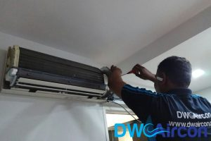 technician-disassembling-aircon-chemical-overhaul-dw-aircon-singapore