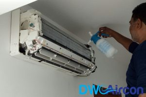 ac-technician-applying-solution-aircon-chemical-cleaning-dw-aircon-singapore