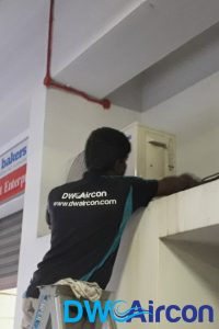 ac-technician-performing-HDB-aircon-installation-dw-aircon-singapore