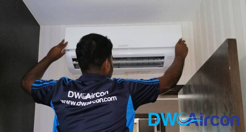 ac-technician-performing-aircon-installation-dw-aircon-singapore_featured