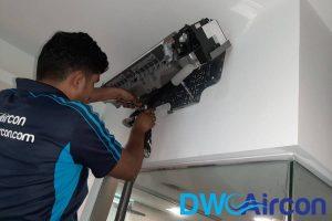 ac-technician-repairing-aircon-installation-dw-aircon-singapore