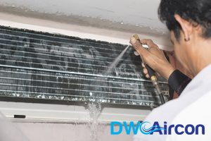 technician-chemically-washing-aircon-chemical-wash-neccessary-for-my-aircon--servicing-singapore